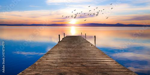 Canvastavla paisaje de un embarcadero sobre el mar en calma