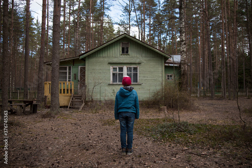 Obraz na płótnie Stranger Things.Mysterious boy in front of a cabin in the woods.