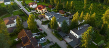 Top Drone View Of Luxury Cottage Village Near Green Forest. Modern Architecture. Private Sector.