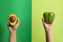 Female Hands Hold Pepper And A...