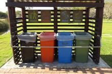 Plastic Garbage Bins In The Park