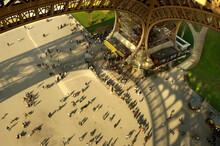 Tourists Under Eiffel Tower In...
