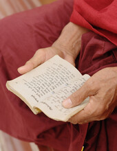 Close Up Of Buddhist Monk Holding Scripture Book, Burma