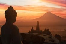 Buddha At Sunset, The Buddhist Temple Of Borobudur, Java, Indonesia
