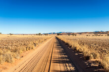 Dirt Road In Plain Landscape A...