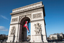 View Of French Flag And Arc De Triomphe, Paris, France