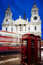 View Of Entrance Of St Pauls Cathedral And Red Phone Box At Night, London, UK