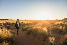 Woman Hiking Through Arches Na...