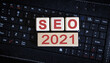 canvas print picture - SEO 2021 concept. Wooden cubes on a black keyboard