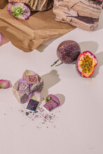 Passion Fruit With Petals And Powders On Table