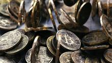 Close Up Of Pile Of Tumbling Golden Bitcoins