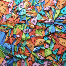 Colorful Paper With Printed Icons Folded Into Triangles