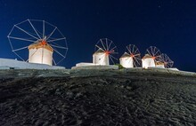View Of Windmills Against Sky At Night