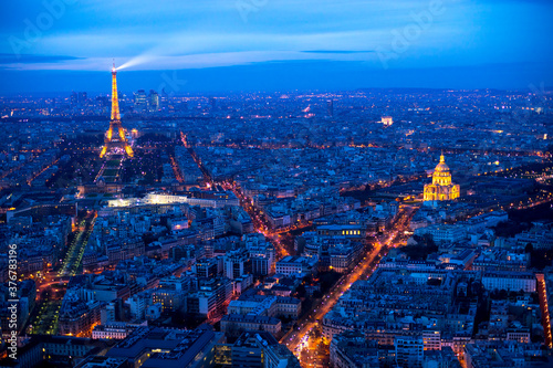High angle view of Eiffel Tower and Les Invalides in city at night - 376783196