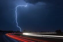 Light Trail Against Lightning ...