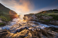 First Light Over Swiftcurrent Falls In Glacier National Park, Montana