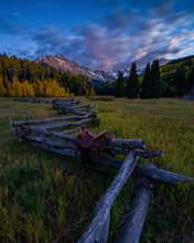 Saddle On Split Rail Fence Against Mount Sneffels During Sunrise