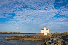 View Of Coquille River Lighthouse Against Cloudy Sky