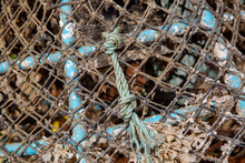 A Close Up Of The Ropes Of A Lobster Pot Used For Fishing