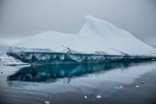 Iceberg Drifting On Frigid Water Coast Of Booth Island In Antarctic Peninsula