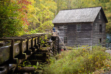 Men Standing Near Mingus Mill In Great Smoky Mountains National Park
