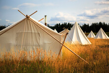 White Tents On Grassy Landscape At Under Canvas Yellowstone