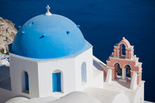 Blue And White Church In Village Of Oia On Greek Island