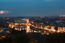 Illuminated Ponte Vecchio Bridge At Night