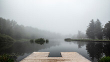 View Of Dock On Lake In Jester Park Nature Center During Fog