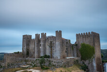 Exterior View Of Castle Against Cloudy Sky During Sunset