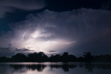 Scenic View Of Lightning Over Lake At Night