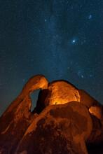Granite Rock Arch Under Starry Night Sky In Alabama Hills Of California