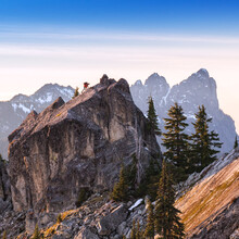 Man Climbing On Large Granite Summit Rock In North Cascades