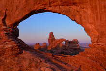 Scenic View Of Turret Arch In Arches National Park During Sunset