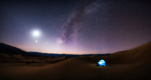 View Of Illuminated Tent On Mesquite Flat Sand Dunes At Night