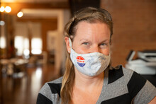 Caucasian Woman Wearing A Mask And An I Voted Today Sticker On The Mask
