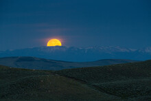 Scenic View Of Blood Moon And Mountain Range