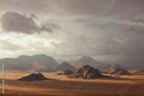 View of rock formations against stormy clouds in sky - 376795369