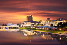Scenic View Of City Reflected In River Torrens At Night