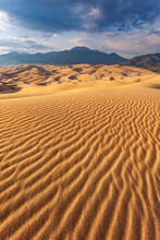 Scenic View Of Sand Dunes In Desert Landscape During Sunset