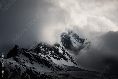 Scenic view of Matterhorn Mountain covered with snow against cloudy sky - 376796585