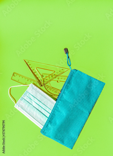 School supplies for children including a mask against covid 19. Back to school