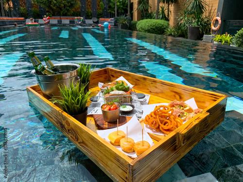 Fototapeta Breakfast in swimming pool, floating breakfast in luxurious hotel