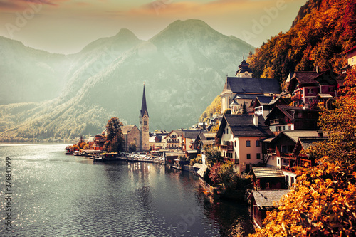 Beautiful Hallstatt is situated between the southwestern shore of Hallstätter See and the steep slopes of the Dachstein massif Canvas Print