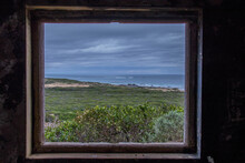 Seascape Viewed Through And Framed By The Window In An Old And Ruined Building On A Hill Above The Shore Image In Landscape Format