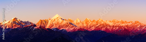 Panoramic view during sunset over snow cladded Panchchuli peaks falls in great Himalayan mountain range from small hamlet Munsiyari, Kumaon region, Uttarakhand, India Wallpaper Mural