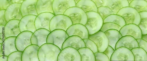 Obraz na plátně Close up of fresh cucumber slices background; vegetable for vegan food