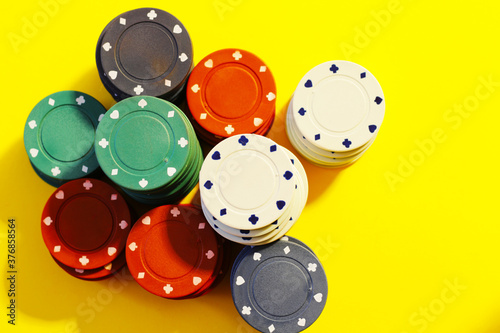 poker chips on yellow background Canvas Print