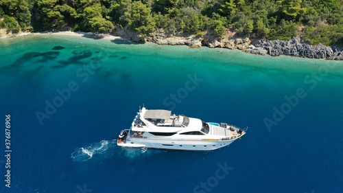 Obraz na plátně Aerial drone photo of yacht anchored in famous crystal clear bay and turquoise b