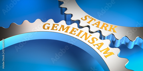 Photographie Concept: Phrase strong together in German language gemeinsam stark on gears fitting into each other